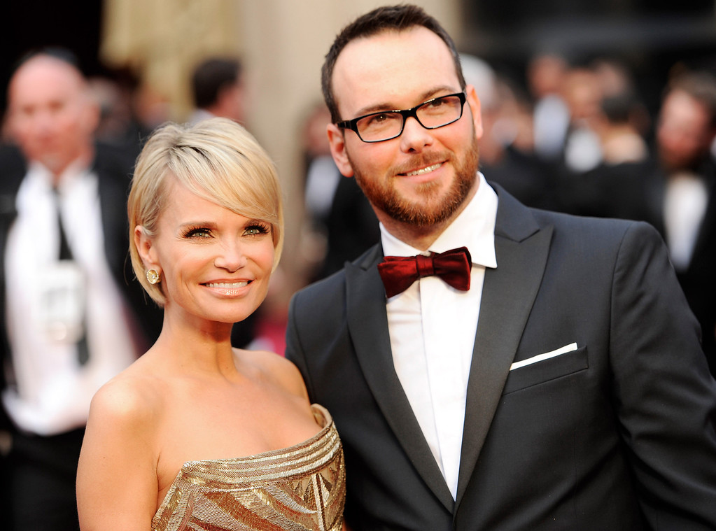 . Kristin Chenoweth, left, and Dana Brunetti arrive at the Oscars on Sunday, March 2, 2014, at the Dolby Theatre in Los Angeles.  (Photo by Chris Pizzello/Invision/AP)