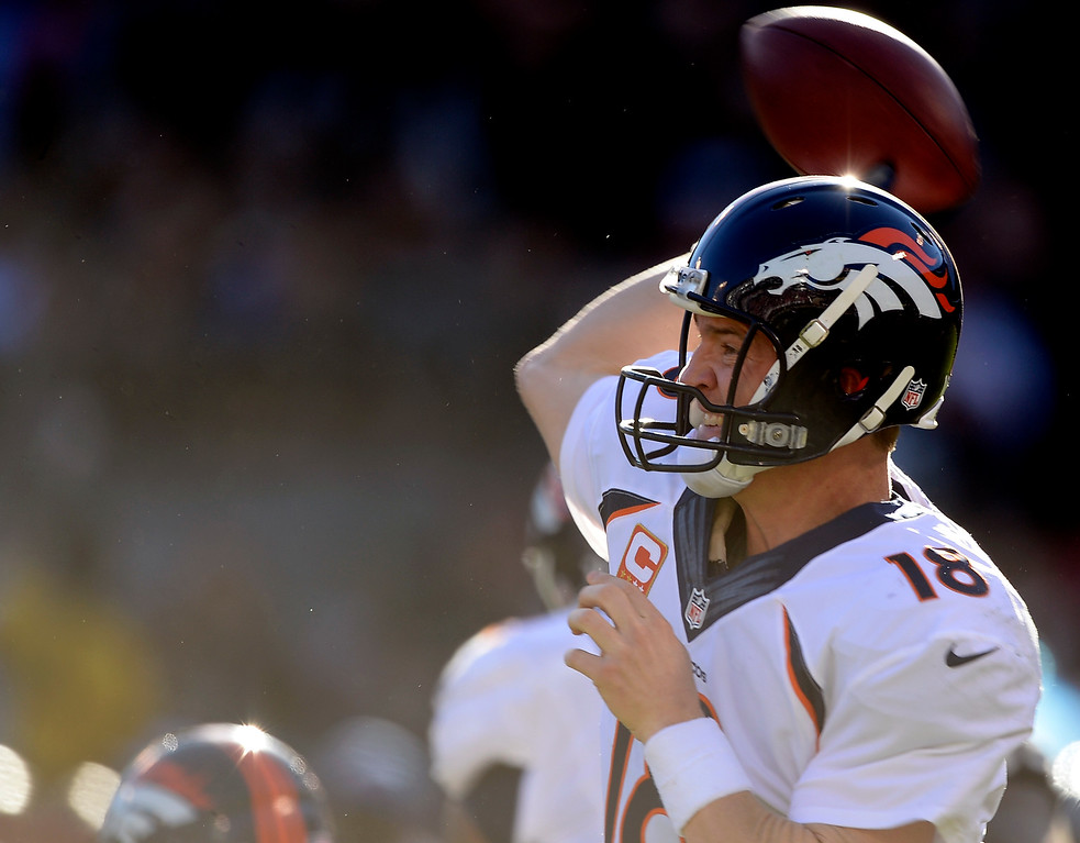. Denver Broncos quarterback Peyton Manning (18) throws a pass downfield during the second quarter against the Oakland Raiders at O.co Coliseum. (Photo by John Leyba/The Denver Post)