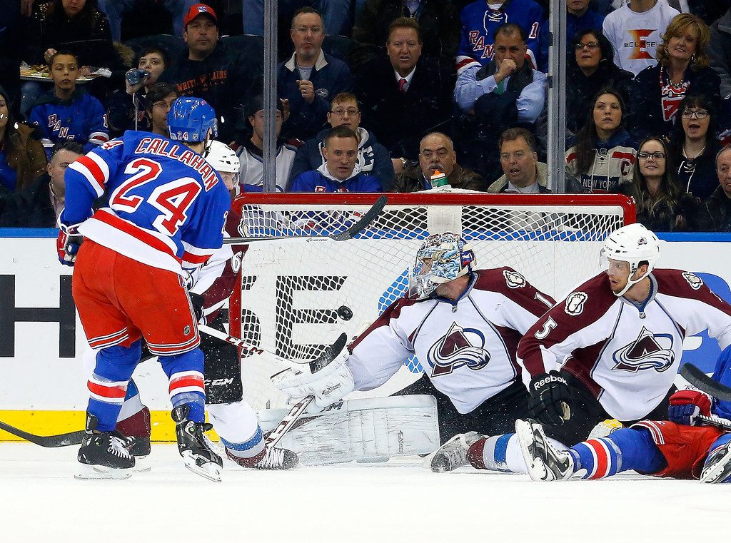 . Ryan Callahan #24 of the New York Rangers scores his second goal of the first period against Semyon Varlamov #1 of the Colorado Avalanche at Madison Square Garden on February 4, 2014 in New York City.  (Photo by Jim McIsaac/Getty Images)