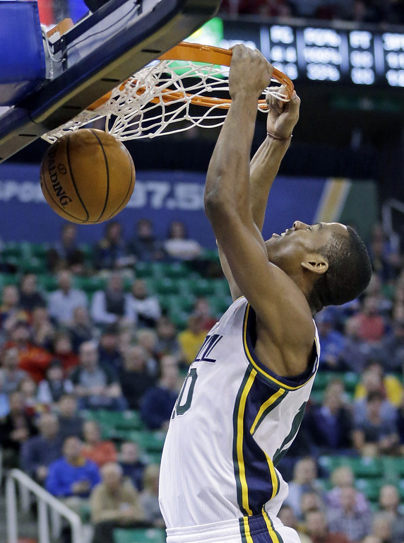 . Utah Jazz\'s Alec Burks (10) dunks the ball against the Denver Nuggets in the first quarter during an NBA basketball game Monday, Jan. 13, 2014, in Salt Lake City. The Jazz won 118-103. (AP Photo/Rick Bowmer)