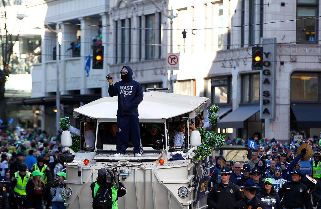 . Marshawn Lynch #24 of Seattle Seahawks celebrates waves to fans during a parade to celebrate their  victory in Super Bowl XLVII on February 5, 2014 in Seattle, Washington.  (Photo by Jonathan Ferrey/Getty Images)