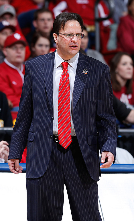 . Head coach Tom Crean of the Indiana Hoosiers looks on from the sideline in the first half against the Temple Owls during the third round of the 2013 NCAA Men\'s Basketball Tournament at UD Arena on March 24, 2013 in Dayton, Ohio.  (Photo by Joe Robbins/Getty Images)