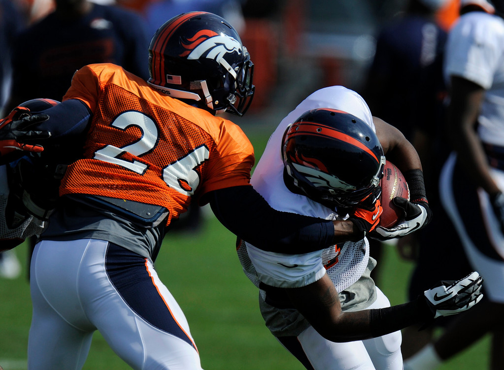 . ENGLEWOOD, CO - JULY 27: Denver Broncos WR, Kemonte Bateman, right, gets a face full from Broncos FS, Rahim Moore, left, during training camp drills at Dove Valley Saturday July 26, 2013.  (Photo By Andy Cross/The Denver Post)