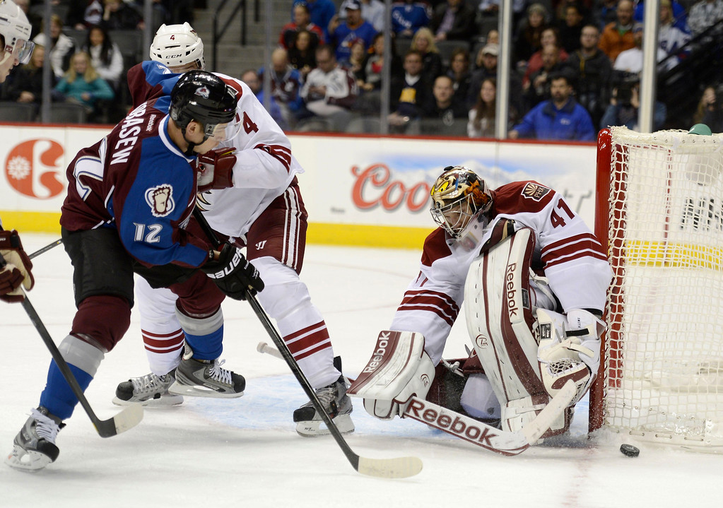 . DENVER, CO. - FEBRUARY 11: Chuck Kobasew (12) of the Colorado Avalanche takes a shot on goal as G Mike Smith (41) of the Phoenix Coyotes makes the save during the first period February 11, 2013 at Pepsi Center. Zbynek Michalek (4) of teh Phoenix Coyotes defends on the play. (Photo By John Leyba/The Denver Post)