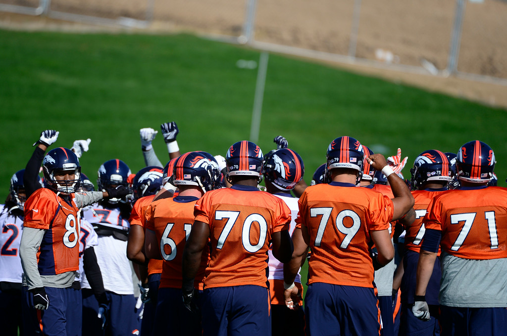 . The players meet on the field together to start practice. The Denver Broncos practice at Dove Valley on Monday, Sept. 1, 2014 in preparation for their season opener against the Indianapolis Colts on Sunday night. (Kathryn Scott Osler/The Denver Post)