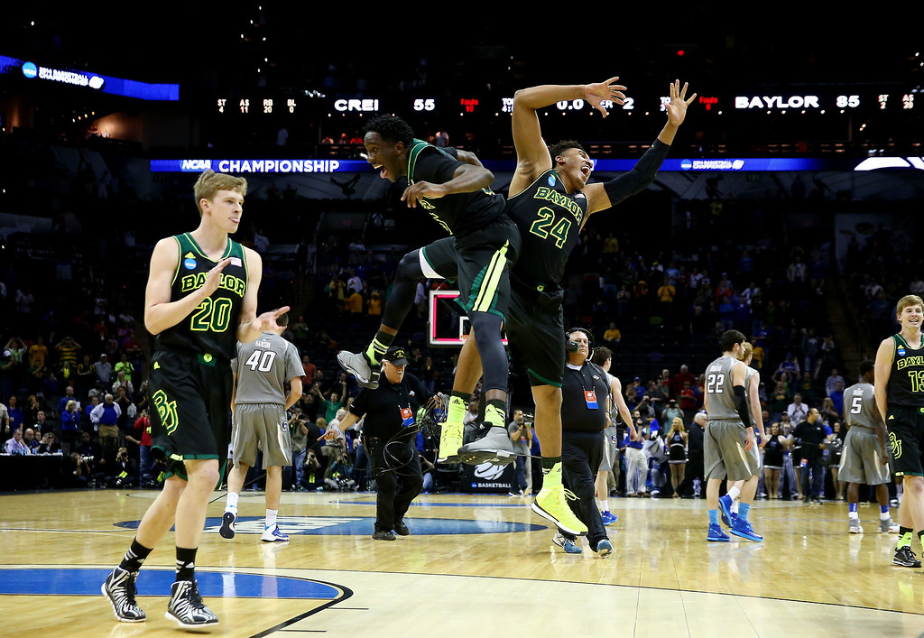 . Taurean Prince #35 and Ish Wainright #24 of the Baylor Bears celebrate after defeating the Creighton Bluejays 85-55 in the third round of the 2014 NCAA Men\'s Basketball Tournament at the AT&T Center on March 23, 2014 in San Antonio, Texas.  (Photo by Tom Pennington/Getty Images)