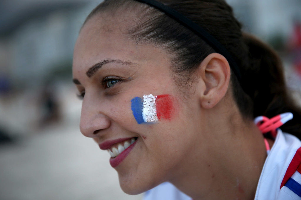 . French soccer team fan, Sephora Senouci, from France, wears the color of her countries flag as she enjoys Copacabana beach while waiting for the start of the 2014 FIFA World Cup on June 11, 2014 in Rio de Janeiro, Brazil.   Brazil continues to prepare to host the World Cup which starts on June 12th and runs through July 13th.  (Photo by Joe Raedle/Getty Images)