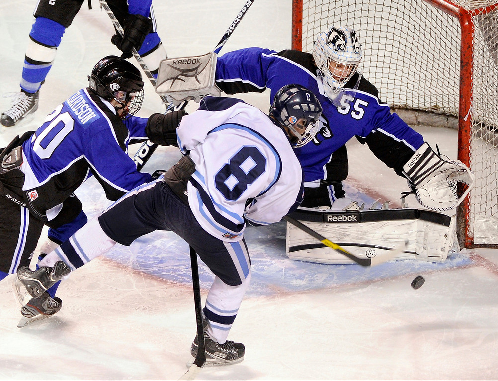 . DENVER, CO. - FEBRUARY 28: Mustangs forward Tanner West (8) tried to get a shot on net in the second period. Ralston Valley High School took on Resurrection Christian Thursday night, February 28, 2013 in a semifinal match in the Colorado State Ice Hockey Championships at Magness Arena in Denver. (Photo By Karl Gehring/The Denver Post)