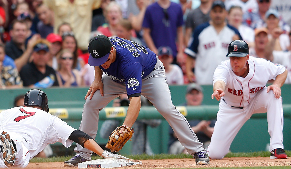 . Stephen Drew #7 of the Boston Red Sox slides in to third on a triple as Nolan Arenado #28 of the Colorado Rockies is late with the tag in the 6th inning at Fenway Park on June 26, 2013 in Boston, Massachusetts.  (Photo by Jim Rogash/Getty Images)