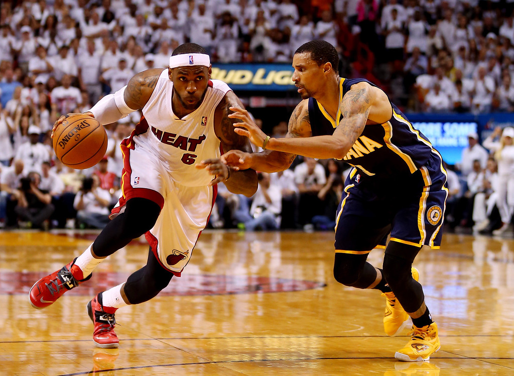. LeBron James #6 of the Miami Heat drives to the basket as George Hill #3 of the Indiana Pacers defends during Game Four of the Eastern Conference Finals of the 2014 NBA Playoffs at American Airlines Arena on May 26, 2014 in Miami, Florida.  (Photo by Mike Ehrmann/Getty Images)