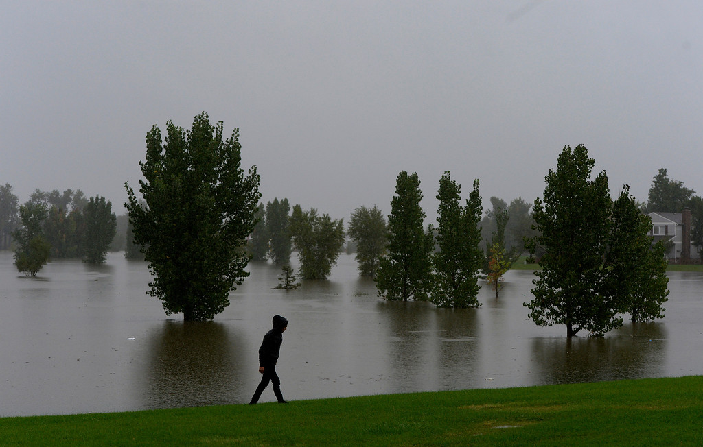 . AURORA, CO. - SEPTEMBER12:  A man looks over the flooded Expo Park in Aurora CO September 12, 2013.Heavy rains have snarled traffic, flooded streets and parks but not resulted in reports of casualties or structure damage, Mayor Steve Hogan said Thursday. (Photo By Craig F. Walker / The Denver Post)
