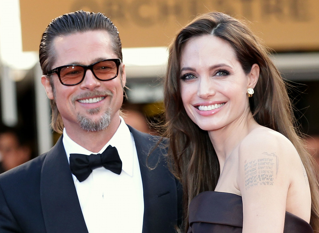 """. Angelina Jolie (R) and Brad Pitt attend \""""The Tree Of Life\"""" premiere during the 64th Annual Cannes Film Festival at Palais des Festivals on May 16, 2011 in Cannes, France.  (Photo by Andreas Rentz/Getty Images)"""
