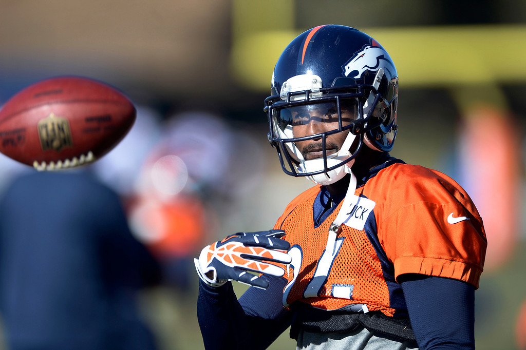 . Denver Broncos cornerback Champ Bailey (24) flips the football during drills at practice November 27, 2013 at Dove Valley (Photo by John Leyba/The Denver Post)