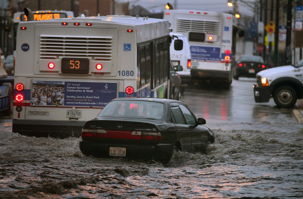 . CHICAGO, IL - APRIL 18:  A motorist drives through standing water in a flooded underpass on April 18, 2013 in Chicago, Illinois.  (Photo by Scott Olson/Getty Images)