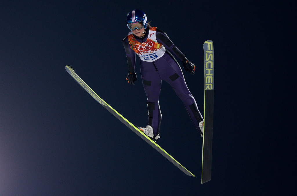 . Germany\'s Carina Vogt makes her trial jump in the women\'s ski jumping normal hill final at the 2014 Winter Olympics, Tuesday, Feb. 11, 2014, in Krasnaya Polyana, Russia. (AP Photo/Matthias Schrader)