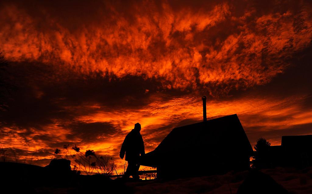 . Jim Annesser walks along the Clear Creek Trail, Tuesday, January 03, 2012 as the sun rises over Golden. RJ Sangosti, The Denver Post