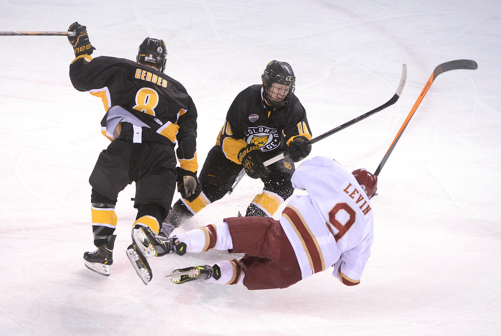 . Colorado College wing Luc Gerdes (8) levels Denver wing Gabe Levin (9) in front of Colorado College center Cody Bradley (10) during a hockey game Friday night, Feb. 21, 2014, in Denver. (AP Photo/The Denver Post, Karl Gehring) NEW YORK POST OUT   NEW YORK DAILY NEWS OUT  MAGS OUT  NO SALES  TV OUT  ONLINES OUT