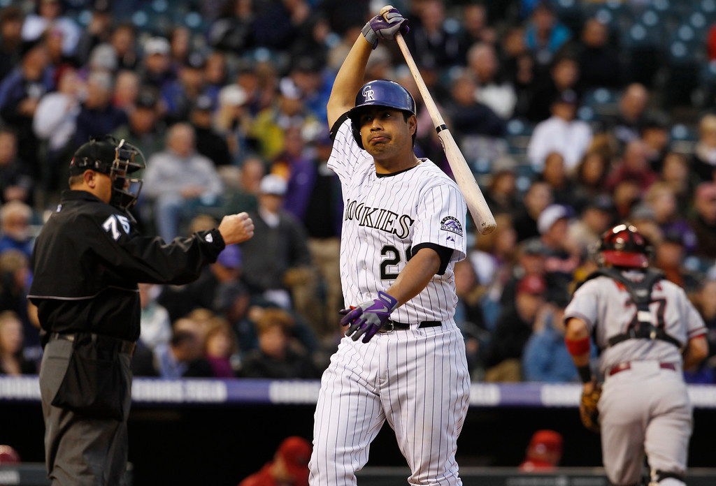 . Colorado Rockies\' Jorge De La Rosa, center, reacts after striking out while swinging to end the fourth inning of a baseball game in Denver on Saturday, April 20, 2013. (AP Photo/David Zalubowski)