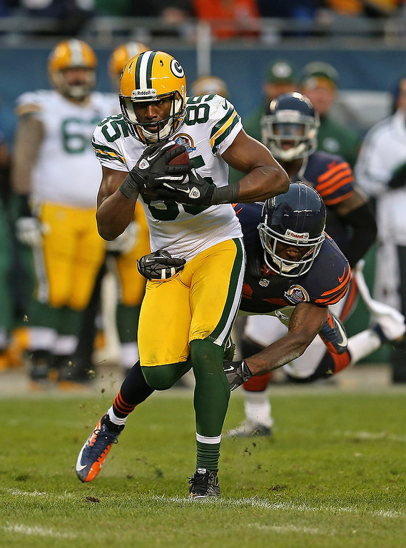 . Greg Jennings #85 of the Green Bay Packers catches a pass in front of Kelvin Hayden #24 of the Chicago Bears at Soldier Field on December 16, 2012 in Chicago, Illinois. The Packers defeated the Bears 21-13. (Photo by Jonathan Daniel/Getty Images)