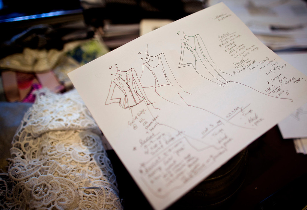 . A sketch for a design by Carmen Marc Valvo is placed on fabric in his New York studio. Valvo\'s Spring 2014 collection will be shown during New York Fashion Week on Sept. 6 at Lincoln Center. (AP Photo/John Minchillo)
