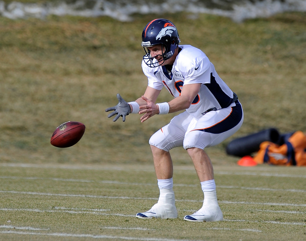 . Denver Broncos quarterback Peyton Manning (18) takes the snap during practice December 18, 2013 at Dove Valley (Photo by John Leyba/The Denver Post)