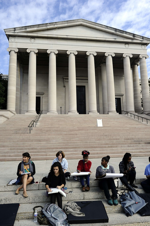 . A group of art students take up the staircase of the National Art Gallery as it is closed due to Federal government shutdown in Washington, DC, on October 1, 2013. The US government shut down Tuesday for the first time in 17 years after a gridlocked Congress failed to reach a federal budget deal amid bitter brinkmanship. Some 800,000 federal workers have been furloughed in a move reminiscent of two previous shutdowns -- for six days in November 1995 and 21 days from December that year into early 1996. AFP Photo/Jewel SAMAD/AFP/Getty Images