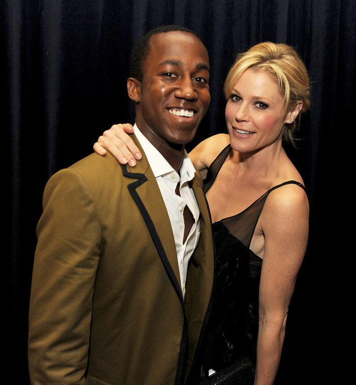 """. Honoree Lenworth Poyser (L) and actress Julie Bowen pose at \""""An Evening\"""" benifiting The L.A. Gay & Lesbian Center at the Beverly Wilshire Hotel on March 21, 2013 in Beverly Hills, California.  (Photo by Kevin Winter/Getty Images)"""