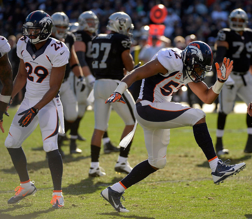 . Denver Broncos middle linebacker Wesley Woodyard (52) celebrates his hit on Oakland Raiders wide receiver Rod Streater (80) for a loss of yards during the first quarter at O.co Coliseum. (Photo by John Leyba/The Denver Post)