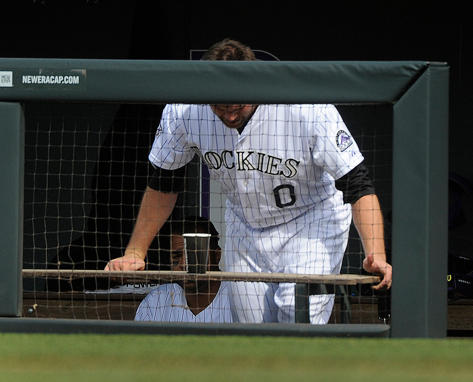 . Colorado reliever Adam Ottavino reacted in the dugout after allowing a run on a wild pitch in the eighth inning. The Colorado Rockies were defeated by the Miami Marlins 5-3 at Coors Field Thursday afternoon, July 25, 2013. Photo By Karl Gehring/The Denver Post