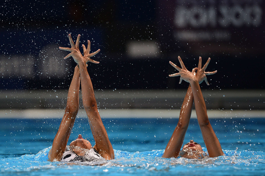. Margalida Crespi Jaume and Spain\'s  Ona Carbonell Ballestero  compete in the duet technical final during the synchronised swimming competition in the FINA World Championships at the Palau Sant Jordi in Barcelona, on July 21, 2013.     JAVIER SORIANO/AFP/Getty Images