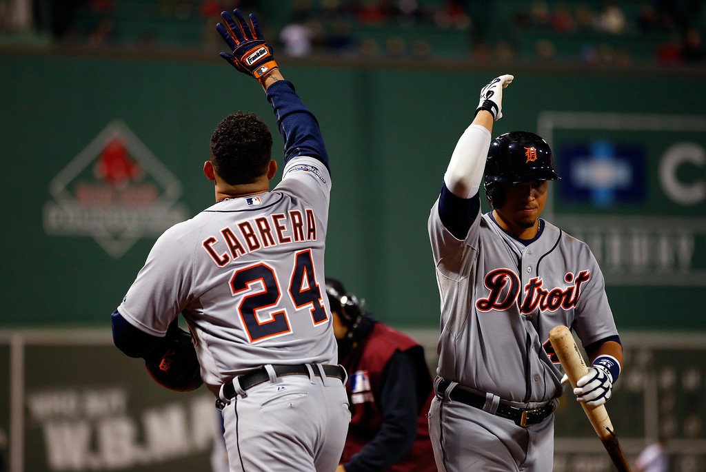 . Miguel Cabrera #24 of the Detroit Tigers celebrates with Victor Martinez #41 after hitting a home run in the sixth inning against the Boston Red Sox during Game Two of the American League Championship Series at Fenway Park on October 13, 2013 in Boston, Massachusetts.  (Photo by Jared Wickerham/Getty Images)