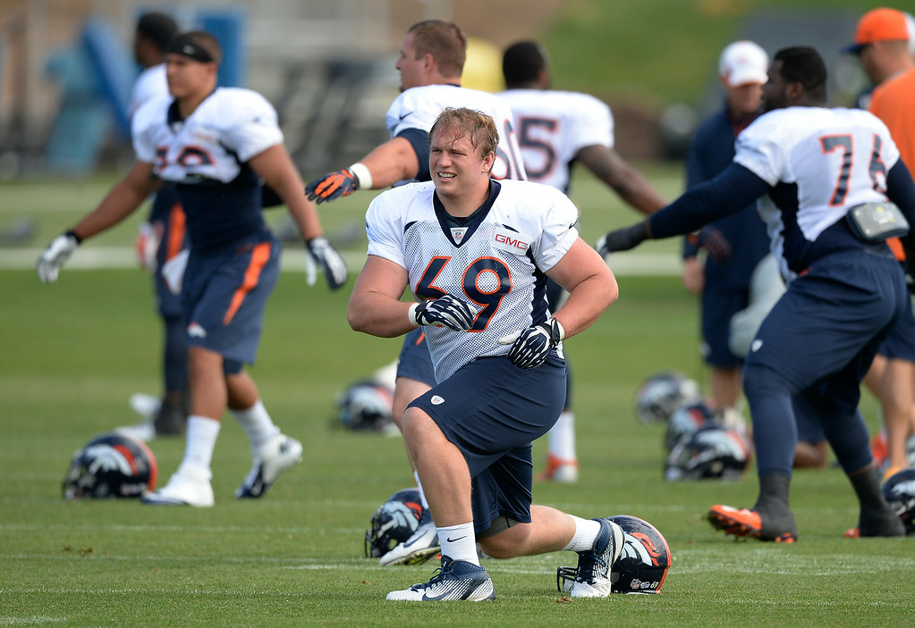 . Denver Broncos Will Pericak (6(0 stretches on day 12 of the Denver Broncos 2014 training camp August 5, 2014 at Dove Valley. (Photo by John Leyba/The Denver Post)