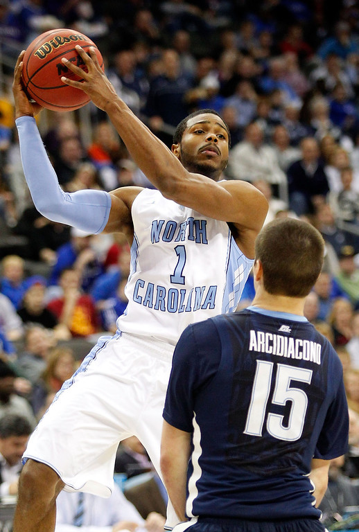 . KANSAS CITY, MO - MARCH 22:  Dexter Strickland #1 of the North Carolina Tar Heels looks to pass against Ryan Arcidiacono #15 of the Villanova Wildcats in the second half during the second round of the 2013 NCAA Men\'s Basketball Tournament at the Sprint Center on March 22, 2013 in Kansas City, Missouri.  (Photo by Ed Zurga/Getty Images)