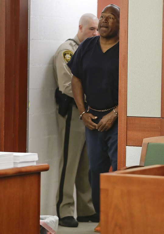 . O.J. Simpson enters the courtroom for his evidentiary hearing in Clark County District Court May 13, 2013 in Las Vegas, Nevada. Simpson, who is currently serving a nine to 33-year sentence in state prison as a result of his October 2008 conviction for armed robbery and kidnapping charges, is using a writ of habeas corpus, to seek a new trial, claiming he had such bad representation that his conviction should be reversed.  (Photo by Julie Jacobson - Pool/Getty Images)