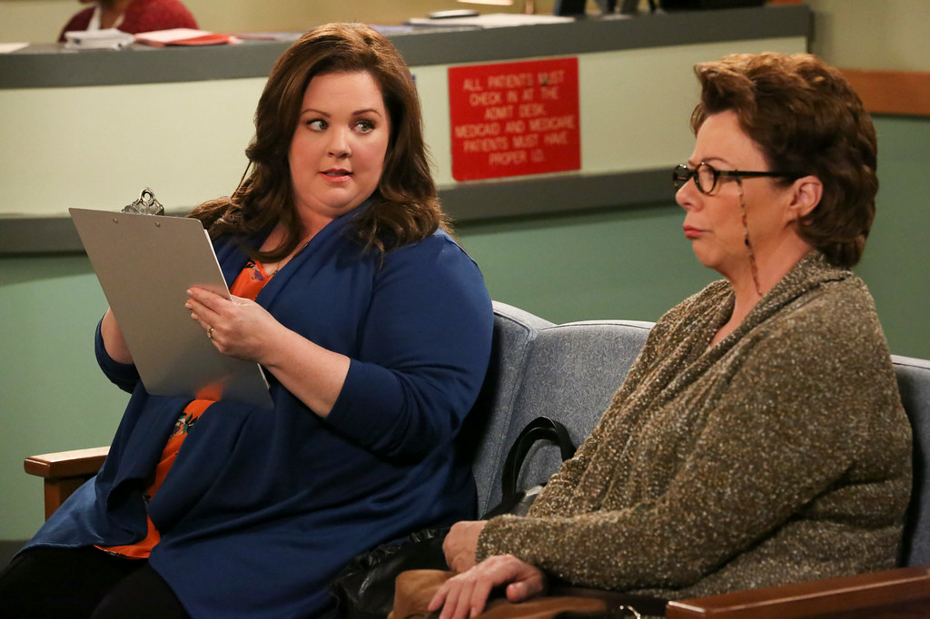 ". This image released by CBS shows Melissa McCarthy as Molly Flynn, left, and Rondi Reed as Peggy Biggs in a scene from ""Mike & Molly.\"" Mccarthy was nominated for an Emmy Award for best actress in a comedy series on Thursday, July 10, 2014. The 66th Primetime Emmy Awards will be presented Aug. 25 at the Nokia Theatre in Los Angeles. (AP Photo/CBS, Robert Voets)"