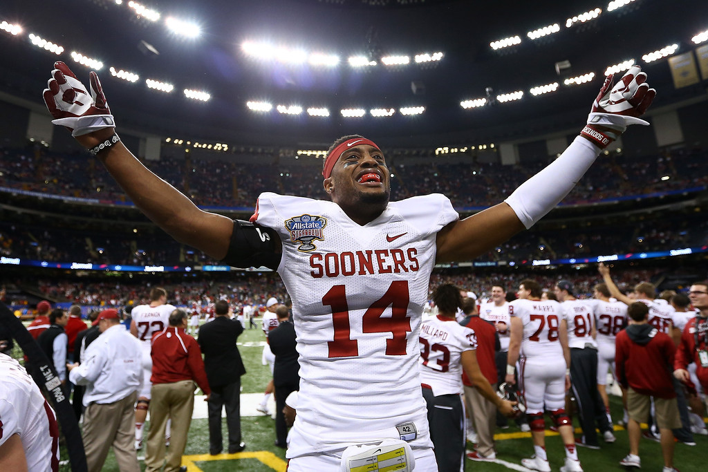 . NEW ORLEANS, LA - JANUARY 02:  Aaron Colbin #14 of the Oklahoma Sooners celebrates after defeating the Alabama Crimson Tide 45-31 during the Allstate Sugar Bowl at the Mercedes-Benz Superdome on January 2, 2014 in New Orleans, Louisiana.  (Photo by Streeter Lecka/Getty Images)
