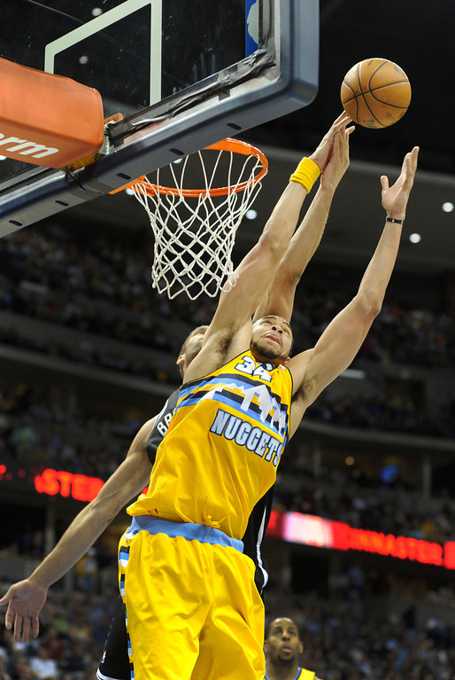 . DENVER, CO. - MARCH 29: JaVale McGee (34) of the Denver Nuggets reached for a rebound in the second half. The Denver Nuggets defeated the Brooklyn Nets 109-87 Friday night, March 29, 2013 at the Pepsi Center in Denver.  (Photo By Karl Gehring/The Denver Post)