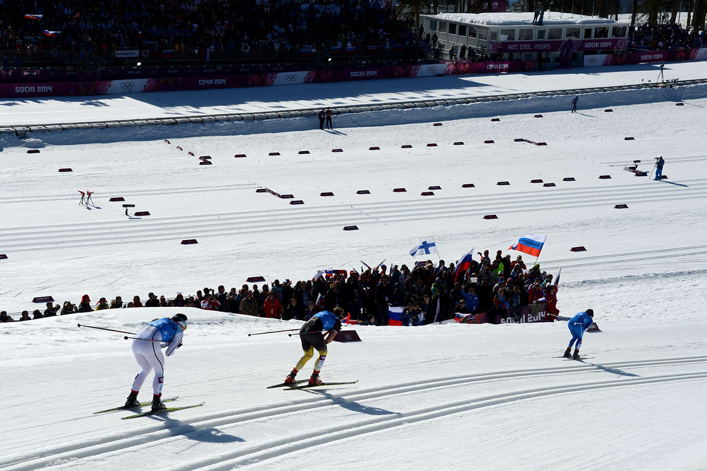 . Sweden\'s Charlotte Kalla (L), Finland\'s Krista Lahteenmaki (R) and Germany\'s Denise Herrmann compete in the Women\'s Cross-Country Skiing 4x5km Relay at the Laura Cross-Country Ski and Biathlon Center during the Sochi Winter Olympics on February 15, 2014, in Rosa Khutor, near Sochi. KIRILL KUDRYAVTSEV/AFP/Getty Images