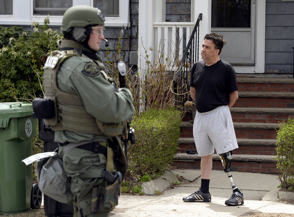 . The Cape Cod, Massachusetts, Police Department SWAT team search houses for the second of two suspects wanted in the Boston Marathon bombings takes place April 19, 2013 in Watertown, Massachusetts.   AFP PHOTO / TIMOTHY A. CLARY/AFP/Getty Images