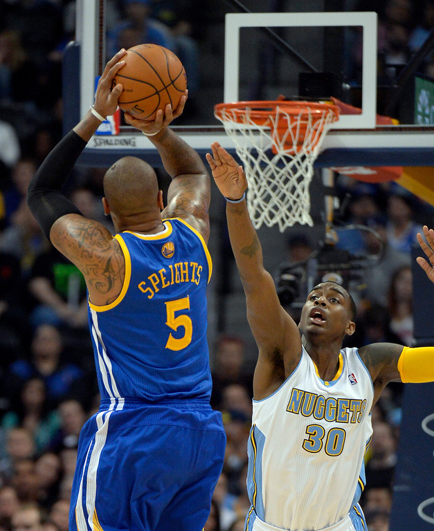 . DENVER, CO - APRIL 16: Golden State Warriors forward Marreese Speights (5) takes a shot ver Denver Nuggets forward Quincy Miller (30) during the first quarter April 16, 2014 at Pepsi Center. (Photo by John Leyba/The Denver Post)