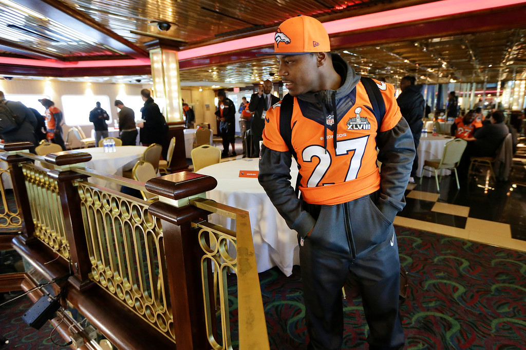 . Denver Broncos running back Knowshon Moreno looks over the railing at the floor below as he leaves the cruise ship where the team\'s daily news conference was held Thursday, Jan. 30, 2014, in Jersey City, N.J. The Broncos are scheduled to play the Seattle Seahawks in the NFL Super Bowl XLVIII football game Sunday, Feb. 2, in East Rutherford, N.J. (AP Photo)