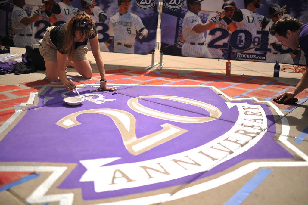 . Laura Rector paints the Rockies logo outside Coors Field before the start of the game. The Colorado Rockies took on the San Diego Padres on Opening Day at Coors Field in Denver, Colorado. (Photo by Hyoung Chang/The Denver Post)