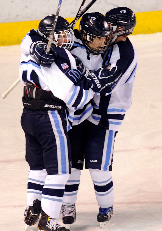 . DENVER, CO. - FEBRUARY 28: Ralston Valley forward Darius  Maes, center, was congratulated by teammates after he knotted up the game at 1-1 in the first period. Monarch High School matched up against Ralston Valley Friday night, March 1, 2013 in the championship game of the state hockey playoffs at Magness Arena in Denver. (Photo By Karl Gehring/The Denver Post)