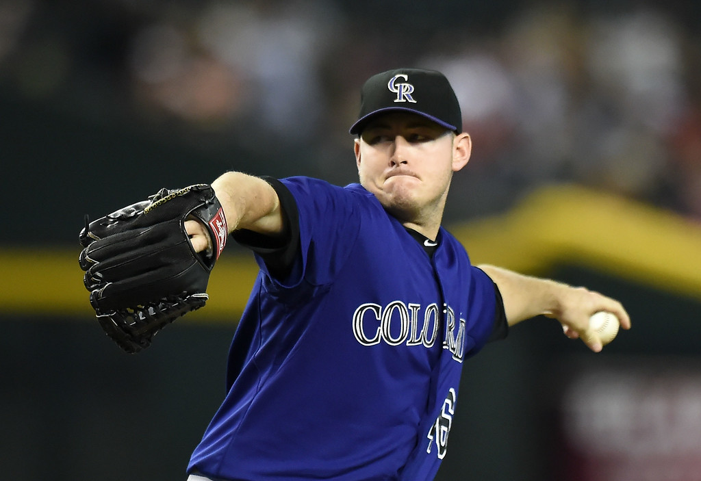 . Tyler Matzek #46 of the Colorado Rockies delivers a first inning pitch against the Arizona Diamondbacks at Chase Field on August 8, 2014 in Phoenix, Arizona.  (Photo by Norm Hall/Getty Images)