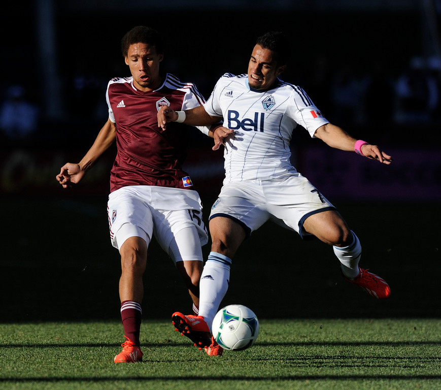 . COMMERCE CITY, CO. - OCTOBER 19: Rapids defender Christopher Klute (15) battled for the ball with Vancouver forward Camilo Sanvezzo (7) in the first half. The Colorado Rapids hosted the Vancouver Whitecaps at Dick\'s Sporting Goods Park Saturday, October 19, 2013. Photo By Karl Gehring/The Denver Post