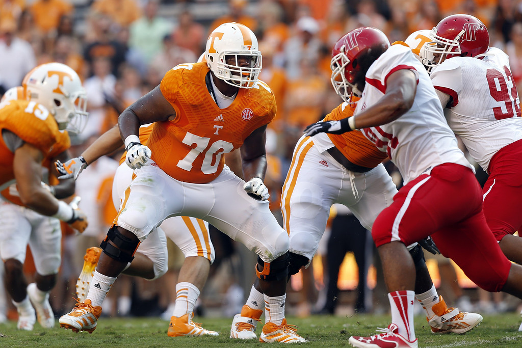 . In this Aug. 31, 2014, file photo, Tennessee\'s Ja\'Wuan James (70) blocks during the first quarter of an NCAA college football game against Austin Peay in Knoxville, Tenn. James was selected in the first round, 19th overall, by the Miami Dolphins in the NFL draft on Thursday, May 8, 2014. (AP Photo/Wade Payne, File)