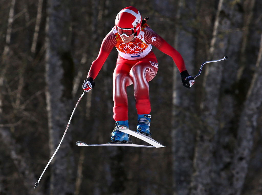 . Switzerland\'s Dominique Gisin makes a jump in the women\'s downhill at the Sochi 2014 Winter Olympics, Wednesday, Feb. 12, 2014, in Krasnaya Polyana, Russia. (AP Photo/Alessandro Trovati)