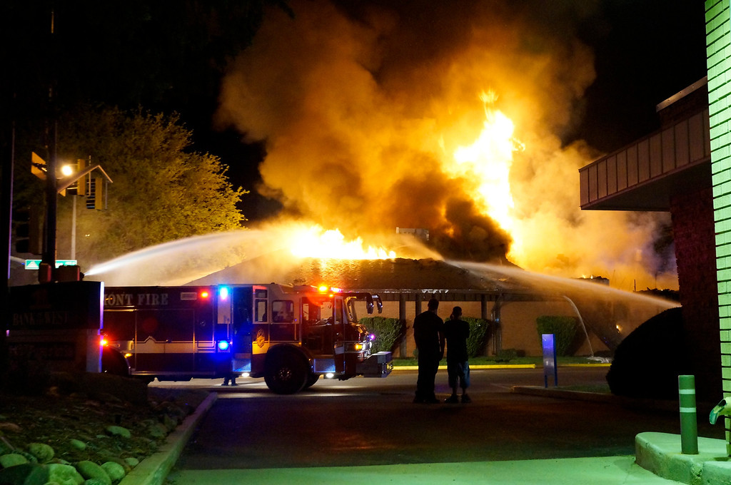 . Bystanders watch as firefighters battle the blaze at Howe Mortuary around 2 a.m. Tuesday morning, May 24, 2013. (Nate Kenworthy/courtesy photo)
