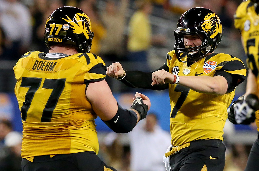 . ARLINGTON, TX - JANUARY 03:  Quarterback Maty Mauk #7 of the Missouri Tigers celebrates with Evan Boehm #77 after Mauk throws a 24-yard touchdown pass in the second quarter against the Oklahoma State Cowboys during the AT&T Cotton Bowl on January 3, 2014 in Arlington, Texas.  (Photo by Ronald Martinez/Getty Images)