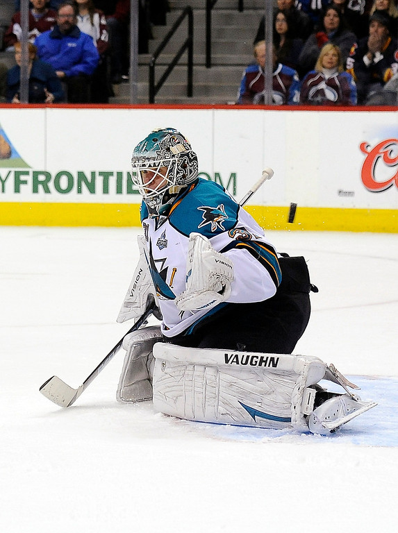 . The puck gets past San Jose Sharks goalie Antti Niemi for the game-winning goal by Colorado Avalanche center Matt Duchene in overtime of an NHL hockey game on Sunday, March 10, 2013, in Denver. The Avalanche won 3-2. (AP Photo/Chris Schneider)